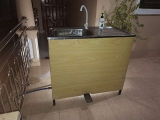 Foot operated water tap with sink